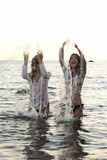 Two women in the water Royalty Free Stock Photography
