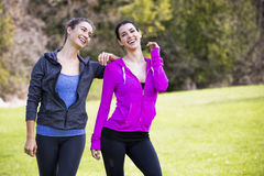 Two women wearing active wear in the park Stock Images