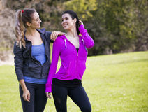 Two women wearing active wear in the park Royalty Free Stock Photo