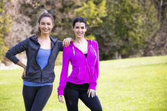 Two women wearing active wear in the park Royalty Free Stock Photography
