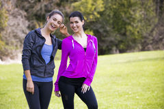 Two women wearing active wear in the park Stock Photo