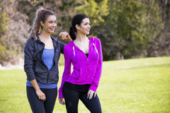 Two women wearing active wear in the park Royalty Free Stock Image