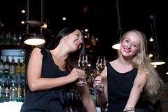 Two women wearing elegant black dresses Royalty Free Stock Photo