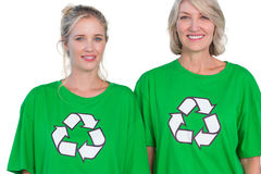 Two women wearing green recycling tshirts. On white background Royalty Free Stock Photo