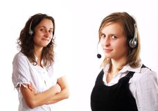 Two women wearing a headset Stock Image