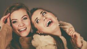 Two women wearing light brown coats Royalty Free Stock Image