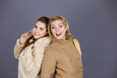Two women wearing light brown coats Royalty Free Stock Photography