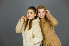 Two women wearing light brown coats Royalty Free Stock Images