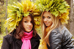 Two women wearing wreaths Royalty Free Stock Photo