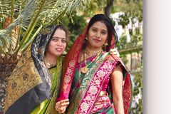 Two women in wedding attire looking at camera, Pune. India stock images