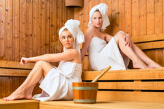 Two women in wellness spa enjoying sauna infusion Royalty Free Stock Images