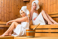 Two women in wellness spa enjoying sauna infusion Stock Images