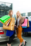 Two women were shopping and driving home Stock Photo