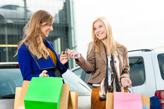 Two women were shopping and driving home Stock Images
