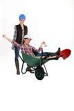 Two women with wheelbarrow Stock Photo