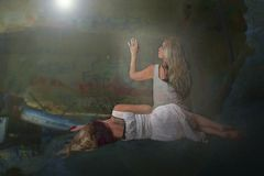 Women and light. Two women in white dresses with spiritual light vector illustration