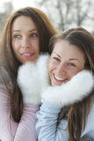 Two women in white mittens Stock Photo