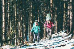 Two women in a winter hike royalty free stock photo