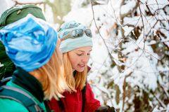 Two women in a winter hike royalty free stock photography