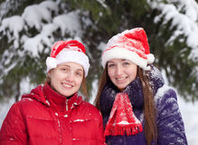 Two women in winter park Royalty Free Stock Image