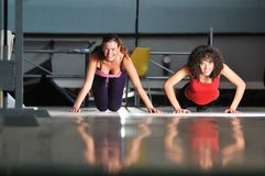 Two women work out  in fitness club Royalty Free Stock Image