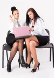 Two women work in team Stock Images