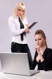 Two women working on a laptop Stock Photography