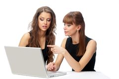 Two women working on a laptop Stock Photo