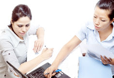 Two women working on laptop Stock Images