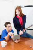 Two women working on the office. Two pretty women working on the office Royalty Free Stock Photography