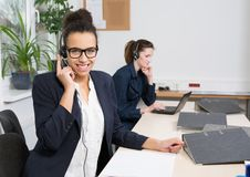 Two women are working in the office Royalty Free Stock Images