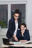 Two women are working in the office Royalty Free Stock Image