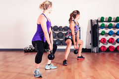Two women working out in gym Royalty Free Stock Images