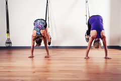 Two women working out with straps Royalty Free Stock Photography