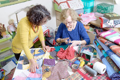 Two women working on their quilting. Two women working on their patchwork in the workshop Royalty Free Stock Photography