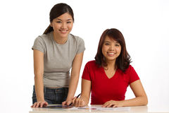 Two women working together Royalty Free Stock Image