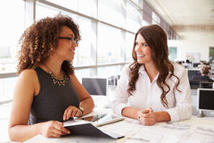 Two women working together at an architect?s office Royalty Free Stock Photography