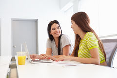 Two Women Working Together In Design Studio Royalty Free Stock Photos