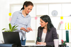Two Women Working Together In Design Studio. Stock Photography