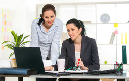 Two Women Working Together In Design Studio. Royalty Free Stock Photos