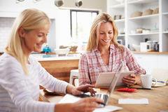 Two women working together at home Royalty Free Stock Image