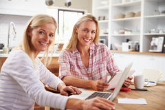 Two women working together at home Royalty Free Stock Photos