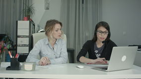 Two women working together in the office stock footage
