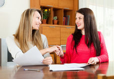 Two women works with papers Stock Images