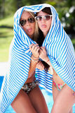 Two Women Wrapped In Towel Pool Stock Photography