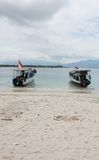 Two wood Boat at White Sand Beach Stock Photos