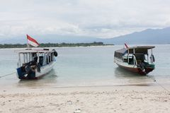 Two wood Boat at White Sand Beach Royalty Free Stock Image