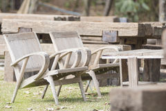 Two wood chairs on the grass. In the garden Royalty Free Stock Image