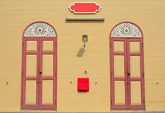 Two Wood Door. And wood wall Stock Image