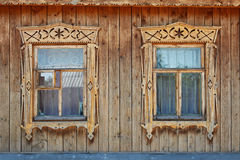 Two Wood Ornate Windows In Russian Old Style Stock Photo